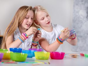 Kids making rubberband Loom